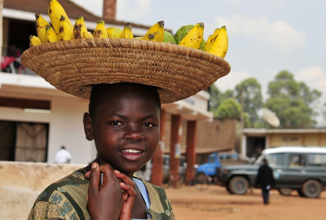 Ugandan boy selling bananas